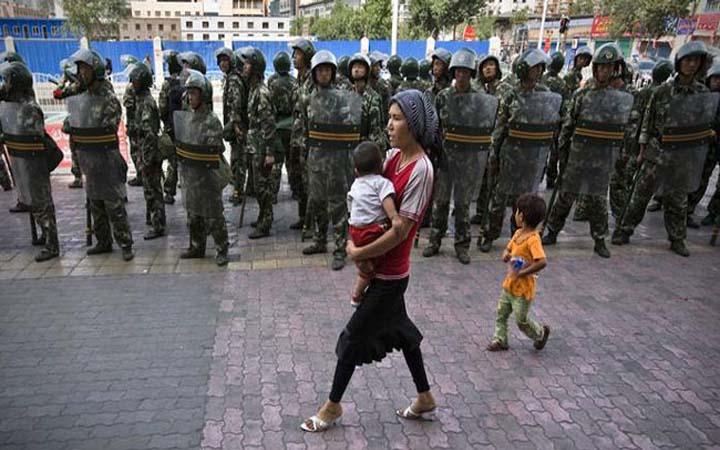 চীন মুসলমানদের মুছে ফেলতে চাইছে : অ্যামনেস্টি